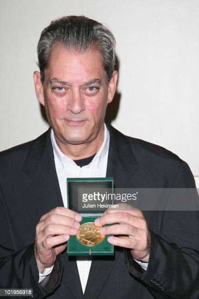 US novelist Paul Auster poses during an award ceremony after receiving the 'Grand Vermeil' medal from the mayor of Paris Bertrand Delanoe on June 10...
