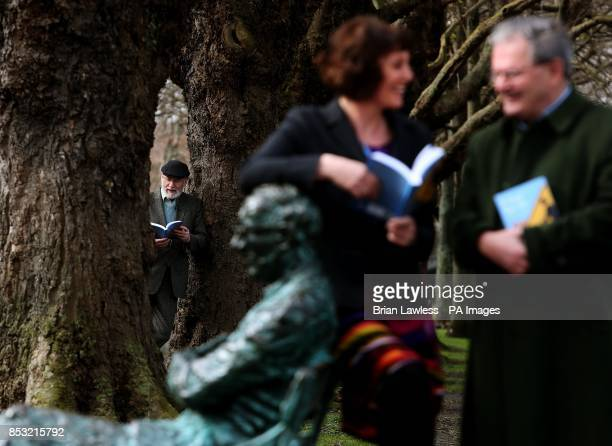 Novelist playwright and poet Dermot Bolger poet Enda Wyley and writer Gabriel Rosenstock next to Patrick Kavanagh's statue on the Grand Canal in...