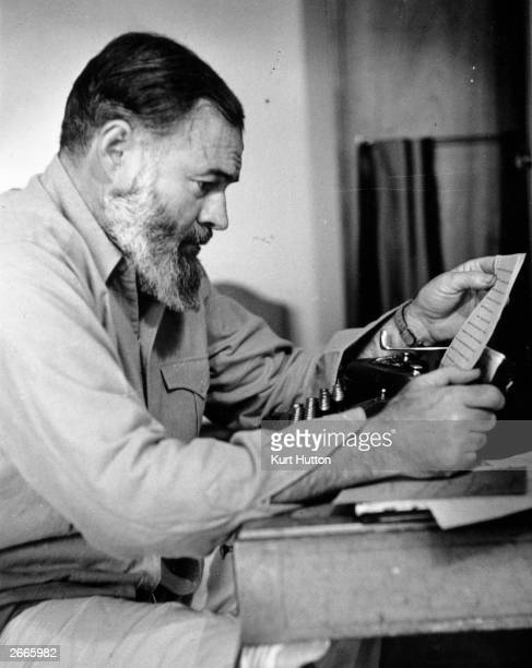 Novelist, short-story writer and war correspondent Ernest Hemingway . Original Publication: Picture Post - 1748 - Hemingway Looks At The War In...