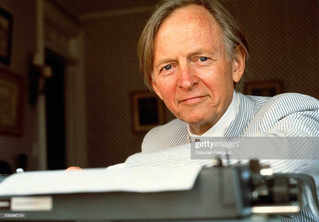 Novelist Tom Wolfe Seated Behind Typewriter