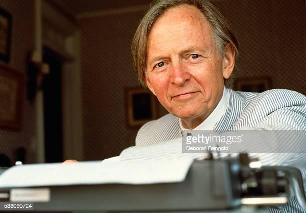 Novelist Tom Wolfe Seated Behind Typewriter