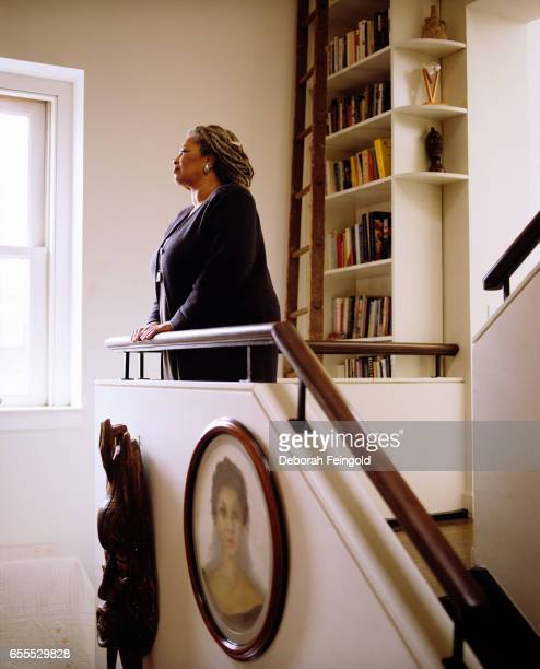 "Novelist Toni Morrison poses in her apartment in December 1997 in New York City, New York. ""r"