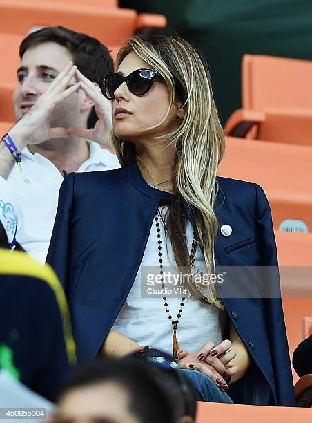 Novella Benini girlfriend of head coach Cesare Prandelli of Italy watches from the stands during the 2014 FIFA World Cup Brazil Group D match between...