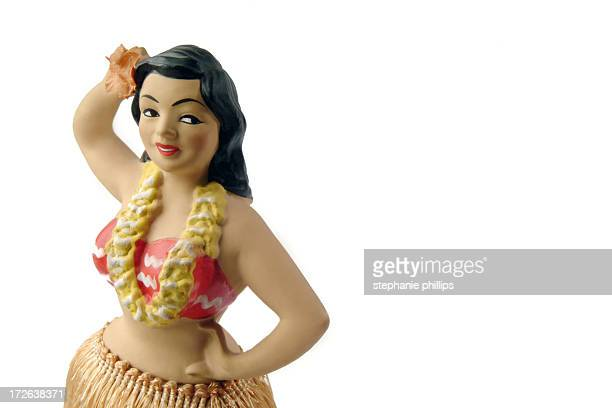 novelty antique hula girl figurine on a white background - hula dancer stock pictures, royalty-free photos & images