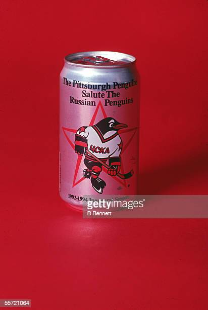 A novelty beer can presented to the Russian Penguins hockey team by the Pittsburgh Penguins shows a penguin in a hockey uniform superimposed on a red...