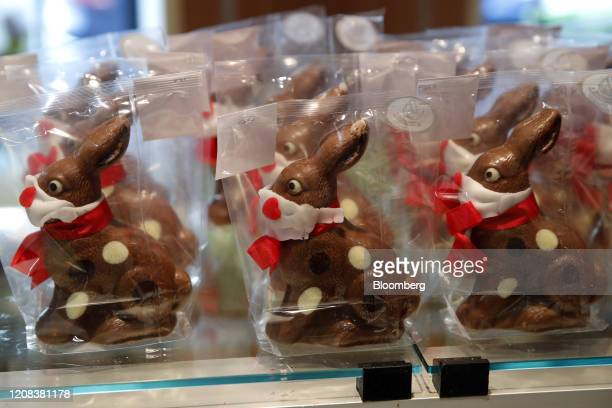 Novelty chocolate easter bunnies with face mask decorations stand on display at Baeckerei Bohnenblust bakery in Bern Switzerland on Thursday March 26...
