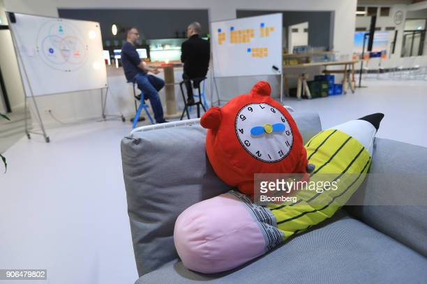 Novelty cushions sit on a sofa in a rest area during the opening of the Robert Bosch GmbH Internet of Things campus in Berlin Germany on Thursday Jan...