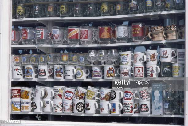 Novelty mugs on sale in a shop in the seaside town of Blackpool Lancashire August 1983