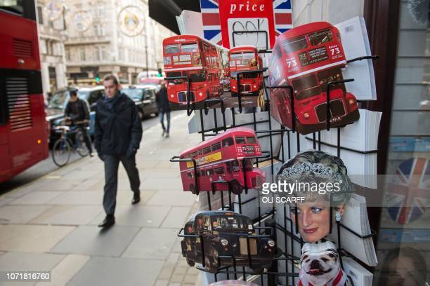 Novelty postcards are displayed for sale outside a souvenir shop in central London on December 11 2018 Embattled British Prime Minister Theresa May...