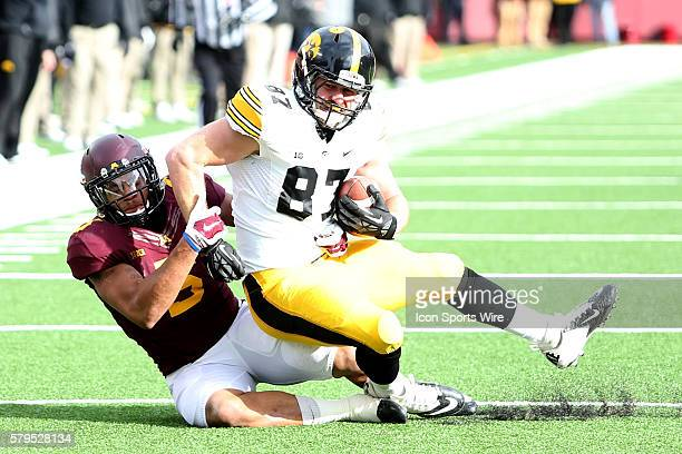 November 08 2014 Gophers linebacker Damien Wilson tackles Hawkeyes Jake Duzey tight end during the third quarter at the Minnesota Gophers game versus...
