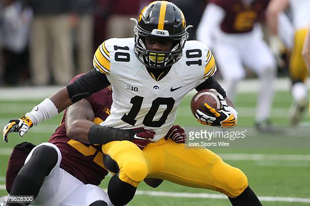 November 08 2014 Hawkeyes Jonathan Parker running back is tackled by Gophers defensive back Briean BoddyCalhoun during the first quarter at the...