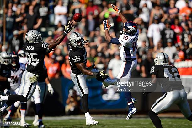 November 09, - Cornerback D.J. Hayden of the Oakland Raiders tips the ball to himself on the 2nd play of the game for an interception at O.co...