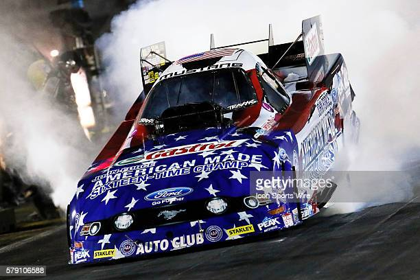 John Force Ford Mustang NHRA Funny Car does a burnout during the 14th Annual NHRA Toyota Nationals at The Strip at Las Vegas Motor Speedway in Las...