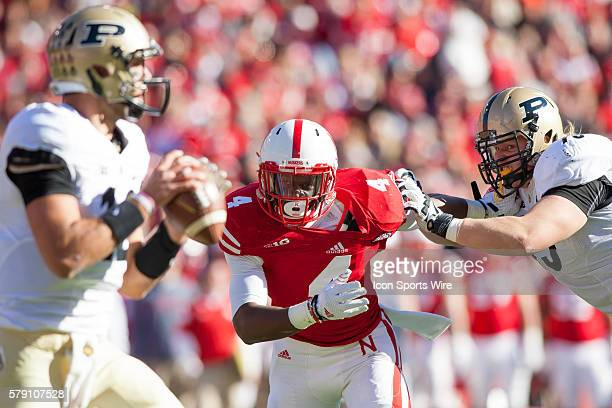 Randy Gregory of the Nebraska Cornhuskers fights off JJ Prince of the Purdue Boilermakers going after Austin Appleby of the Purdue Boilermakers at...