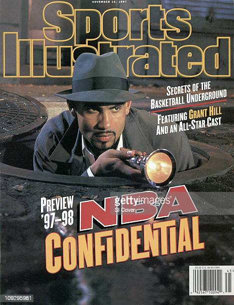 November 10 1997 Sports Illustrated CoverBasketball Season Preview Casual portrait of Detroit Pistons Grant Hill coming out of manhole cover with...