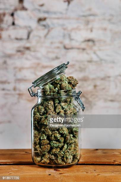 DENVER COLORADO USA – November 10 2014 A jar of recreational marijuana sits on a table in a dispensary in Denver on November 10 2014 In late November...