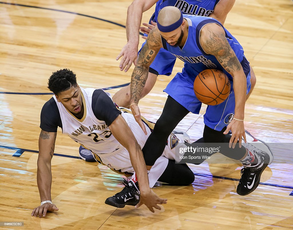 New Orleans Pelicans forward Anthony Davis (23) is knocked to the ground by Dallas Mavericks guard Deron Williams (8) during the game between Dallas Mavericks and New Orleans Pelicans at the Smoothie King Center in New Orleans, LA.