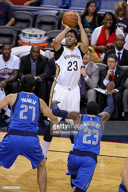 New Orleans Pelicans forward Anthony Davis shoots against Dallas Mavericks center Zaza Pachulia and guard Wesley Matthews during the game between...