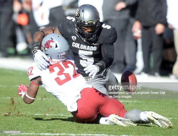 November 10 University of Colorado's Davion Taylor separates the ball from Washington State's James Williamsn