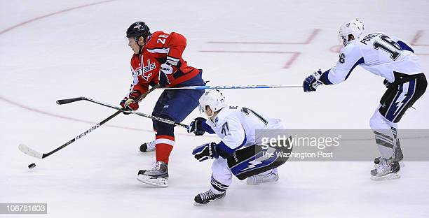 Washington Capitals left wing Alexander Semin beats Tampa Bay Lightning defenseman Victor Hedman and right wing Teddy Purcell down the ice in the 3rd...
