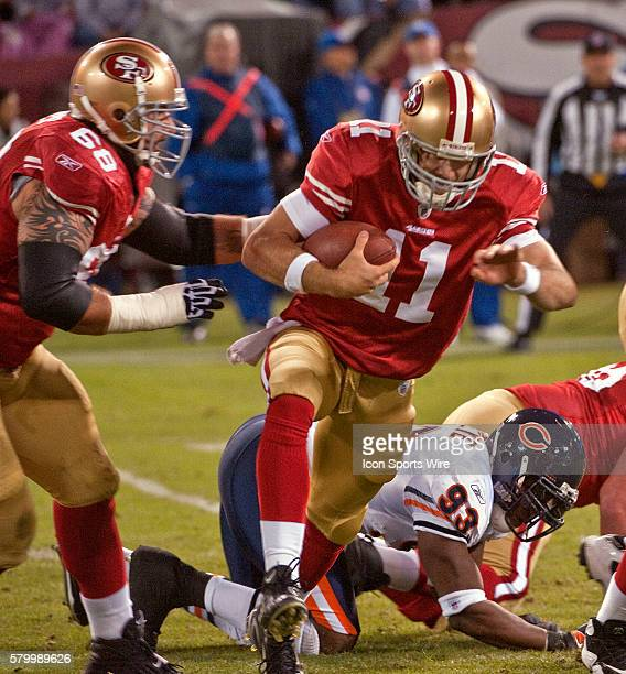 With the help of guard Adam Snyder San Francisco 49ers quarterback Alex Smith runs out of the pocket on Thursday November 12 2009 at Candlestick Park...