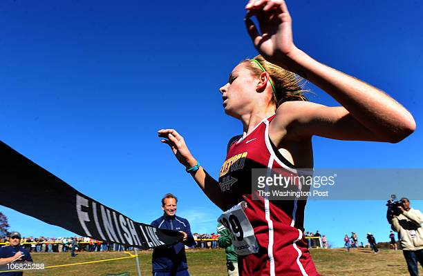 Erin Causey of Hereford high breaks the tape to win the 3A state cross country championship on November 13 2011 in Parkton Md {Photo by Jonathan...