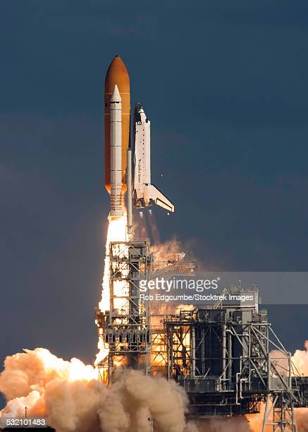 november 16, 2009 - space shuttle atlantis clears the tower at the kennedy space center, cape canaveral, florida. - space shuttle stock photos and pictures