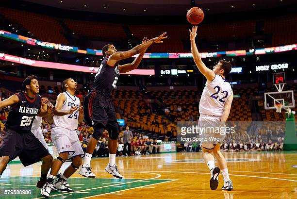 Harvard's Wesley Saunders dishes the ball over Holy Cross' Robert Champion The Holy Cross Crusaders upset the Harvard Crimson 5857 at TD Garden in...