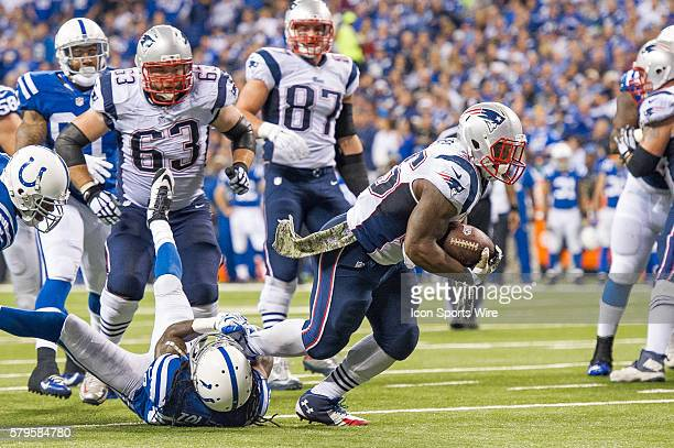 Indianapolis Colts cornerback Greg Toler tackles New England Patriots running back Jonas Gray during a football game between the Indianapolis Colts...