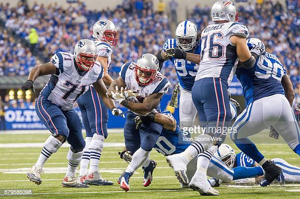 Indianapolis Colts inside linebacker Jerrell Freeman tackles New England Patriots running back Jonas Gray during a football game between the...