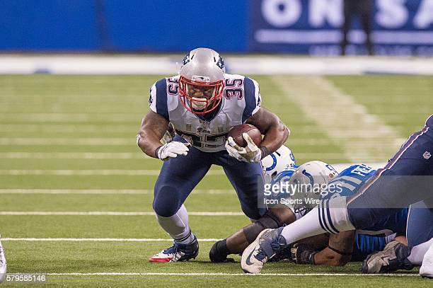 Indianapolis Colts nose tackle Josh Chapman trips up New England Patriots running back Jonas Gray during a football game between the Indianapolis...