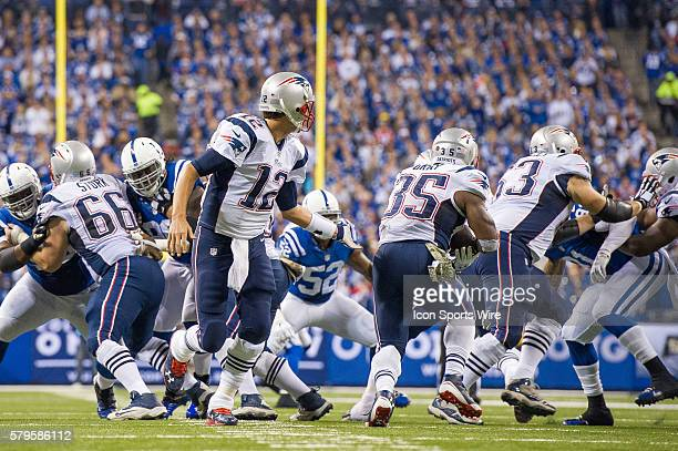 New England Patriots quarterback Tom Brady hands off to New England Patriots running back Jonas Gray during a football game between the Indianapolis...
