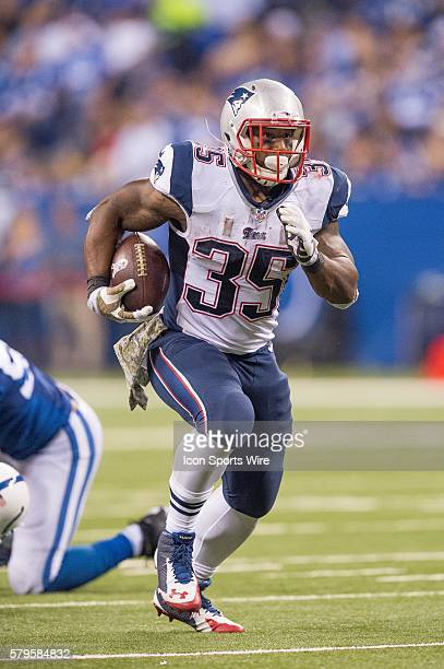 New England Patriots running back Jonas Gray breaks free for a big gain during a football game between the Indianapolis Colts and New England...