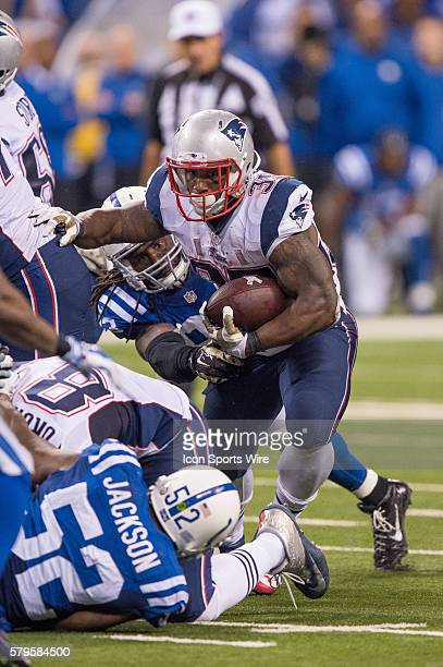New England Patriots running back Jonas Gray gets away from Indianapolis Colts outside linebacker Erik Walden during a football game between the...