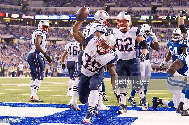 New England Patriots running back Jonas Gray scores on a short run to give New England a 143 lead during a football game between the Indianapolis...