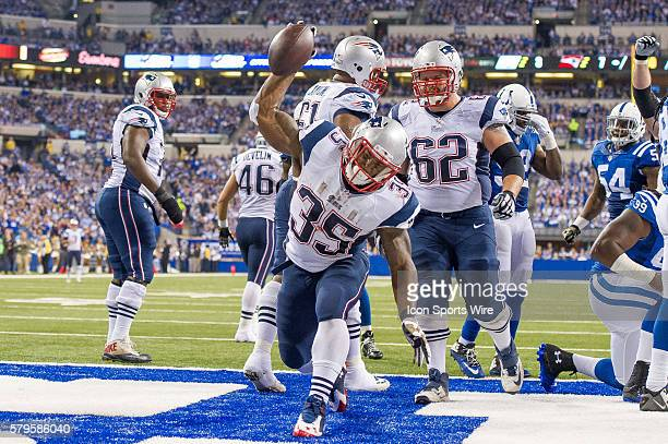 New England Patriots running back Jonas Gray spikes the ball after a touchdown during a football game between the Indianapolis Colts and New England...