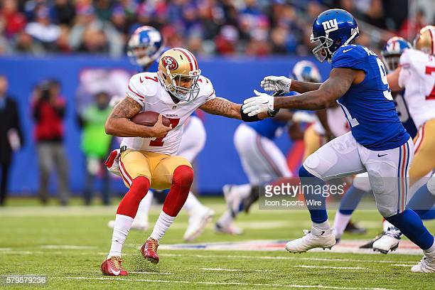 San Francisco 49ers quarterback Colin Kaepernick gets sacked by New York Giants defensive end Robert Ayers during the first half of a NFL game...