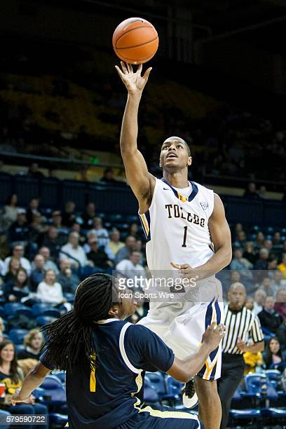 Toledo Rockets guard Jonathan Williams goes in for a layup against Northern Arizona Lumberjacks guard Aaseem Dixon during a nonconference regular...