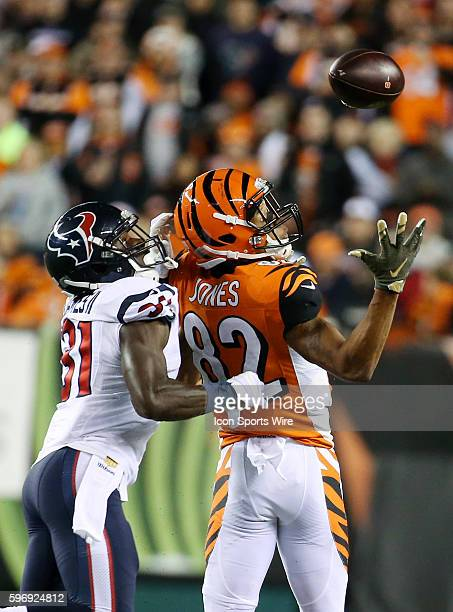 Wide receiver Marvin Jones of the Cincinnati Bengals bobles a pass while defended by cornerback Charles James of the Houston Texans during the second...