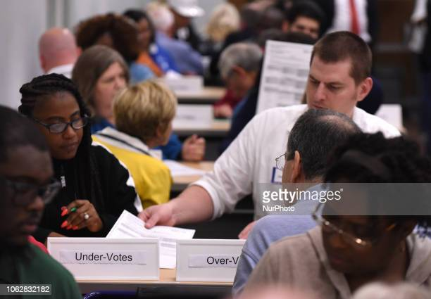 November 16, 2018 - Orlando, Florida, United States - Election workers perform a manual recount of ballots on November 16, 2018 at the Orange County...
