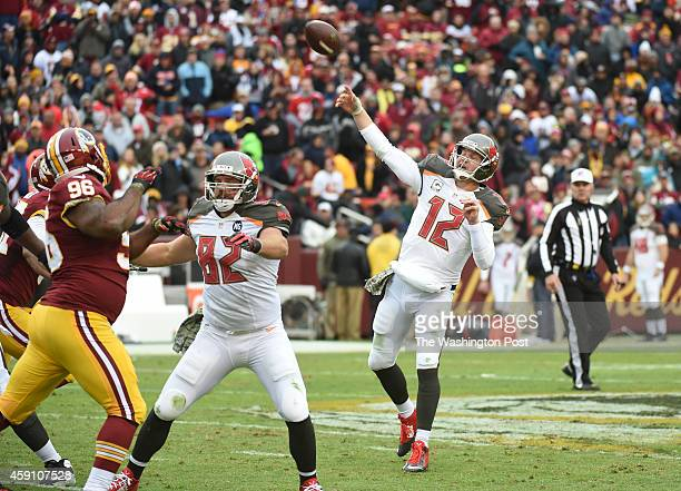 Tampa Bay quarterback Josh McCown throws a third quarter touchdown to wide receiver Mike Evans at FedEx field on November 16 2014 in Landover MD