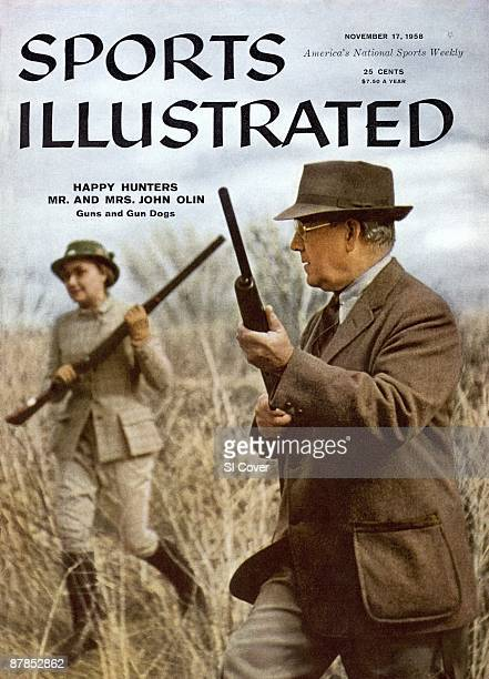 November 17 1958 Sports Illustrated via Getty Images Cover Hunting Olin Kennels owners Evelyn Olin and John Olin hunting for pheasant at Nilo Farms...