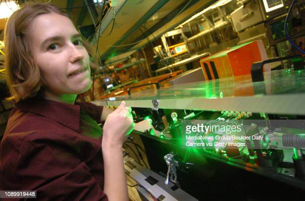 November 17 2004 / Boulder Colo / Doctoral student at the University of Colorado Adela Marian calobrates laser light that she is using to supercool...