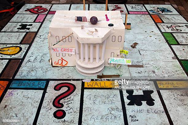 November 17 2011 Occupy Wall Street Protest movement in front of St Paul's Cathedral A recreation of the White House and a Monopoly board sits in...