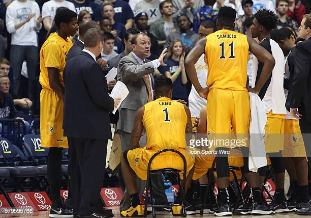 Long Beach State Head Coach Dan Monson talks to his players during a time out in the game between the Long Beach State 49ers and the Xavier...