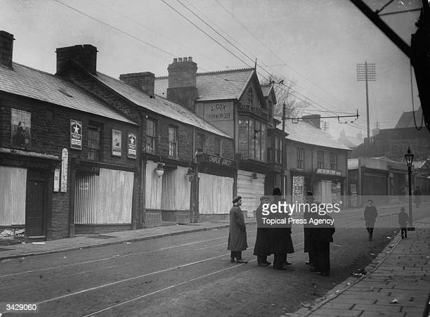 Main street in TonyPandy with shops barricaded during the strikes and riots at Glamorgan Coliery