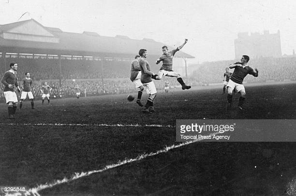 During a match between Chelsea FC and Bradford City FC at Chelsea's ground at Stamford Bridge London a Bradford forward leaps through the Chelsea...