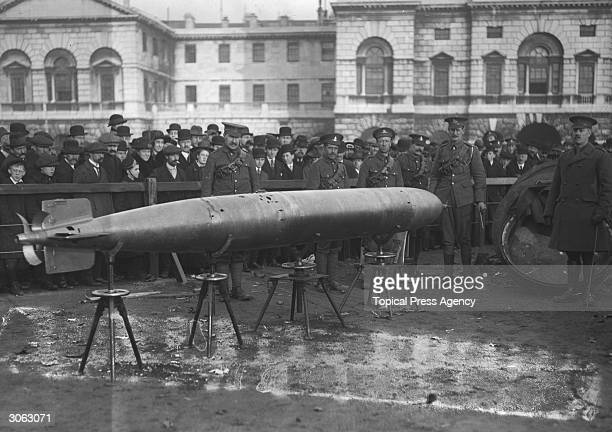 Civilians and soldiers inspect a captured German torpedo on display in the Horseguard's Parade London