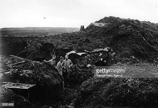 Soldiers in a trench outside a dugout at Verdun