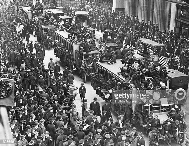 Shipworkers' trucks overflowing with shipworkers celebrating the Armistice parade up Lower Broadway in New York City